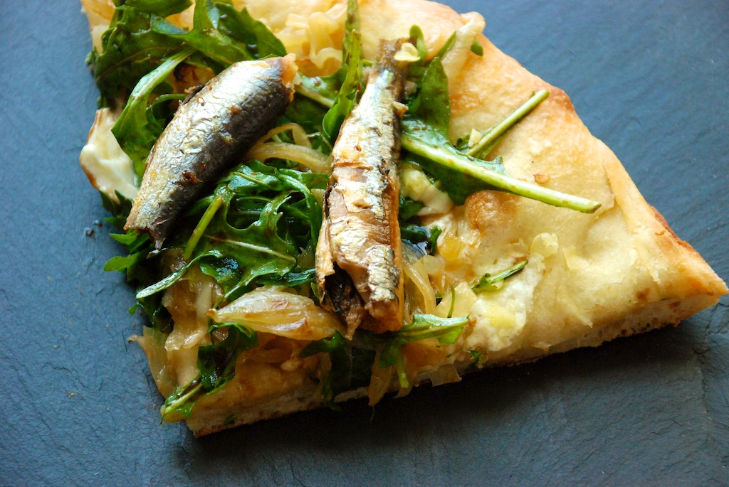 Slice of sardine pizza
