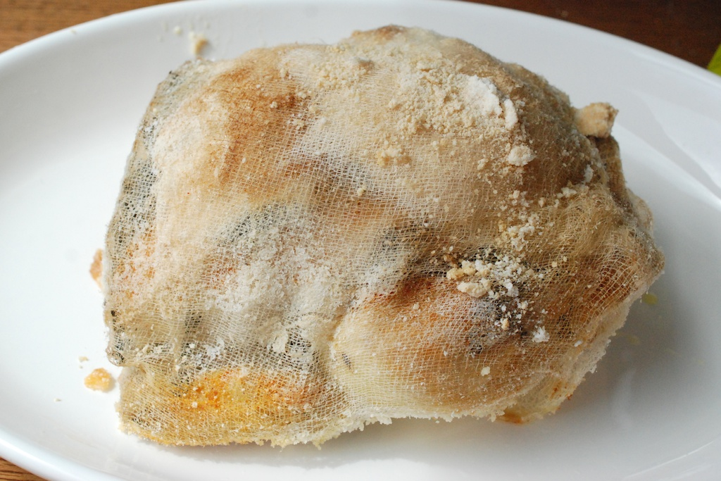 cooked chicken in cheesecloth