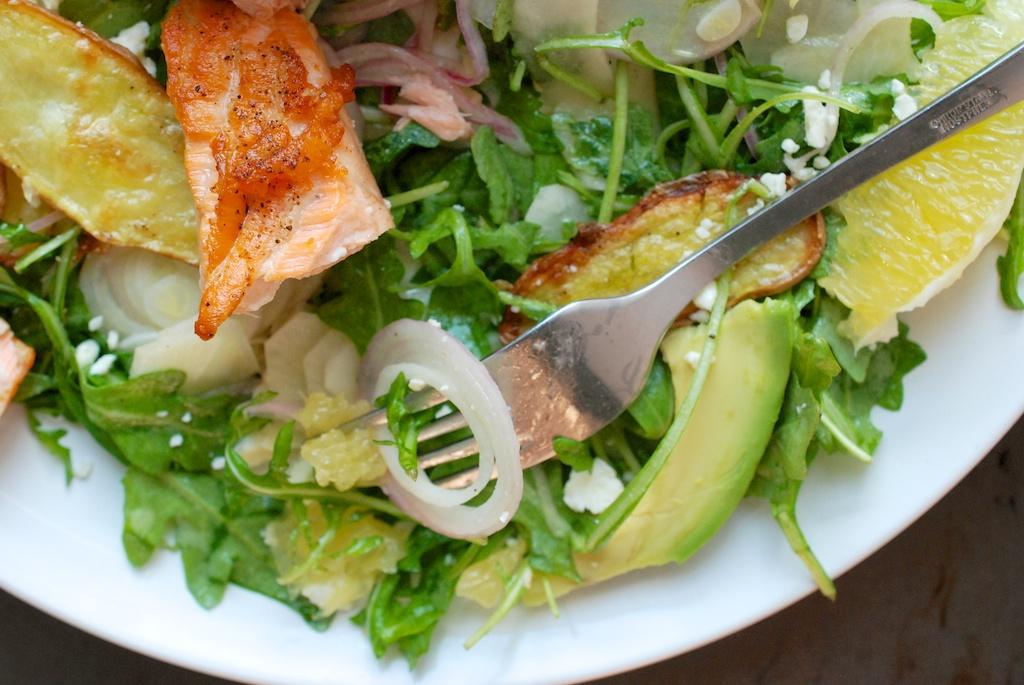 salmon salad, being eaten